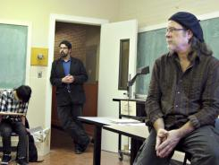 Oregon State University philosophy professors Joseph Orosco, left, and Tony Vogt lead a discussion during a political philosophy of Occupy Wall Street class meeting in Corvalis, Ore.
