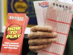Powerball is played in 42 states, Washington, D.C., and the U.S. Virgin Islands. This 2010 file image shows slips for sale in Chicago.