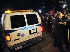 A coroner's van leaves the Beverly Hilton Hotel on Sunday. Whitney Houston was found under water and unconscious a day earlier in the bathtub of her room at the hotel.