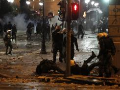 Riots engulfed central Athens and at least 10 buildings went up in flames in mass protests late Sunday as lawmakers prepared to vote on austerity measure.
