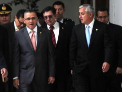 Guatemalan President Otto Perez Molina, right, and his Salvadoran counterpart, Mauricio Funes, meet at the presidencial palace in Guatemala City on Monday to discuss security and drug trafficking.