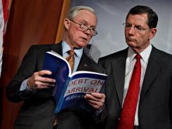 "Sens. Jeff Sessions, R-Ala., and John Barrasso, R-Wyo., labeled the president's budget ""Debt on Arrival."""