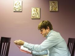 Michael Voris, who produces Real Catholic TV, takes a moment to reflect in the chapel at his Ferndale, Mich., studio on Friday.