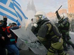 Police clash with demonstrators Sunday in Athens.