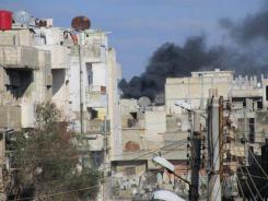 The Syrian government shells the Baba Amr neighborhood in Homs province on Feb. 12.