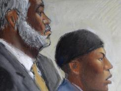 In this file courtroom drawing, Umar Farouk Abdulmutallab, center, appears in U.S. District Judge Nancy Edmunds' courtroom in Detroit with Anthony Chambers, his lawyer who was assisting in his defense, left.