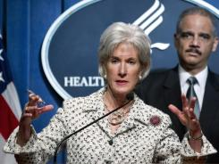 Health and Human Services Secretary Kathleen Sebelius gestures during a news conference announcing the new Health Care Fraud and Abuse Control Program Report on Tuesday.