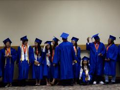 Students from Benson High School await their graduation ceremony in Portland, Ore., in June.