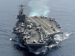 In this photo taken on Jan. 18 and released by U.S. Navy, aircraft carrier USS Abraham Lincoln transits the Indian Ocean.