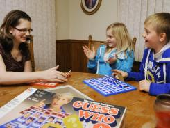 BriAnna Kruzel, left, plays a game Jan. 16 with Samantha Webb, 11, and her brother Dominic, 10.