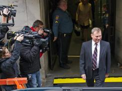 Former Penn State vice president Gary Schultz leaves the Dauphin County Courthouse after the preliminary hearing for athletic director Tim Curley and Schultz on Dec. 16, 2011, in Harrisburg, Pa.