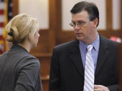 Prosecutor Jeff Swain talks with a colleague Tuesday before the start of Jeffrey Allan Maxwell's trial in a Texas courtroom.