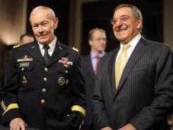 Secretary of Defense Leon Panetta, right, and Gen. Martin Dempsey arrive to testify at a Senate Armed Services Committee hearing Tuesday on Capitol Hill.