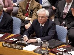Resolution condemning Syria: Russian Ambassador to the U.N. Vitaly Churkin declines to vote Feb. 4 at the U.N. Security Council.