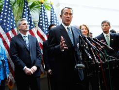 House Speaker John Boehner, accompanied by fellow GOP leaders, discusses the payroll tax cut during a news conference Wednesday on Capitol Hill.