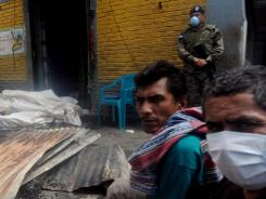 Burned bodies lay covered at a prison after a fire broke out Wednesday in Comayagua, Honduras.