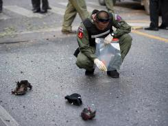 Thai bomb squad officials inspect the site of an explosion Tuesday in Bangkok.