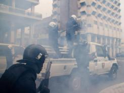Police in riot gear disperse protesters Wednesday in central Dakar, Senegal.