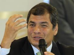 Ecuador's President Rafael Correa speaks to the foreign press at Mercure Hotel in Quito, Ecuador, on Thursday.
