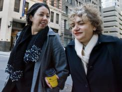 Boston couple:  Beatrice Hernandez, left, and wife Melba Abrue have been married since 2004. Because the federal government doesn't recognize same-sex marriage, they can't file taxes jointly.
