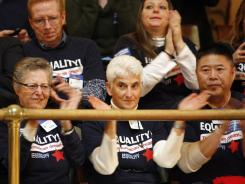 Spectators applaud the passage of<br /><br />