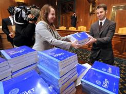 Delivery to Congress: Kathleen Llewellyn hands out copies of the Obama spending plan.