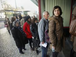 Ana, a 28-year-old unemployed Portuguese woman, waits in line in Lisbon on Jan. 3 to discuss her unemployment benefits. Austerity measures have made it difficult for many Portuguese to find work.