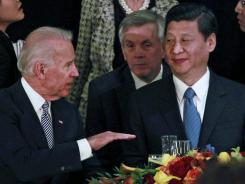 Vice President Joe Biden talks with Chinese Vice President Xi Jinping during a luncheon in Los Angeles on Friday.