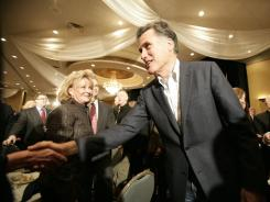 Mitt Romney greets potential voters at the Livonia and Greater Farmington Hills Area Chambers of Commerce luncheon Thursday in Farmington Hills, Mich.