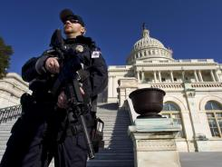 Capitol Police officer Trevor O'Neill guards the Capitol in Washington on Friday after an FBI sting operation foiled an alleged bomb attack.