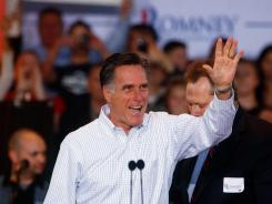 Mitt Romney waves to the crowd at a rally in Mesa, Arizona, on Feb. 13.