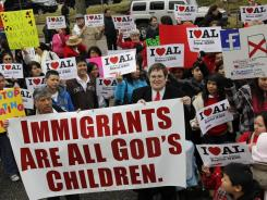 Opponents of Alabama's immigration law gather for a Valentine's Day rally outside the statehouse in Montgomery, Ala., on Tuesday.