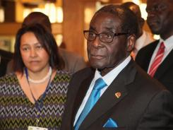 Zimbabwean President Robert Mugabe attends the 20th anniversary of the African Capacity Building Foundation (ACBF) in Harare on Feb. 8.