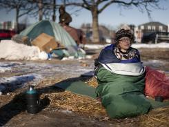 Occupy Maine:  Activist Heather Curtis wakes up on Feb. 10 in Portland. In a Gallup survey, people worry more about jobs and the national debt than the income gap.