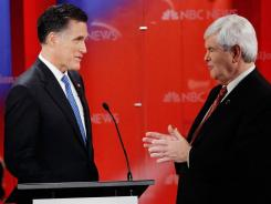 Republican presidential candidates Mitt Romney, left, and Newt Gingrich participate in a GOP debate in Fla. last month.