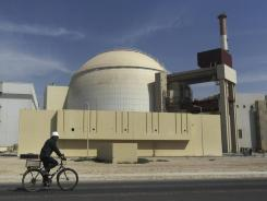 In southern Iran: A worker bikes in front of the Bushehr nuclear power plant last year.