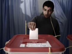 A Misrata resident casts his ballot on Monday during local council elections, the first vote in post-revolution Libya.