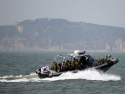 South Korean navy sailors in a speed boat patrol around South Korea's western Yeonpyong Island on Monday after finishing their exercise near the disputed sea border with North Korea.