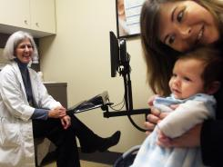 Two-month old Jack Aleskus gets a checkup and immunizations. Seven states are considering making it easier for parents to opt out of mandatory immunization requirements for their children.