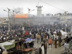 Protesters gather on Tuesday in front of the U.S. base in Bagram, Afghanistan.