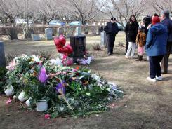 Mourners visit the grave site of singer Whitney Houston on Monday in Westfield, N.J. The cemetery has been closed to the public indefinitely due to increased traffic.