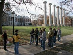 "Prospective students follow a student tour guide around the Francis Quad at the University of Missouri. With more seniors applying for ""early action"" from colleges, more are being deferred."
