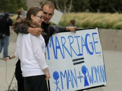 Prop 8 supporters Nadia Chayka and her fiance Luke Otterstad wait to hear the ruling on Prop 8 as they stand outside the Philip Burton Federal building Aug. 4, 2010, in San Francisco.