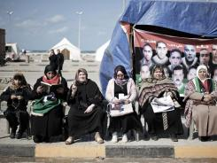 Libyan women who lost relatives in the rebellion against Moammar Gadhafi mark the first anniversary of the uprising Friday in Freedom Square in Benghazi.