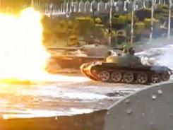 A video uploaded on YouTube shows a tank firing in the Baba Amro neighborhood in the city of Homs, which activists say is being heavily bombarded by government forces.