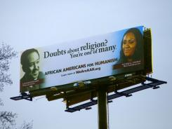 African Americans for Humanism erected billboards in several cities featuring black icons, including Langston Hughes on this billboard in Atlanta, alongside African-American atheists.