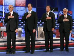 Republican presidential candidates at Wednesday night's debate. From left, Ron Paul, Rick Santorum, Mitt Romney and Newt Gingrich.