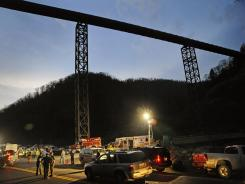 West Virginia State Police direct traffic at the entrance to Massey Energy's Upper Big Branch Coal Mine in Montcoal, W.Va., on April 5, 2010.