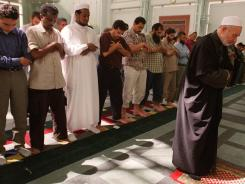 Imam Omar Abu Namous, right, leads prayer service at the Islamic Center of New York. Namous was one of several imams listed in secret New York Police Department documents for preaching non-violence in the wake Muslim outrage around the world to the publication of inflammatory cartoons of Prophet Muhammad in a Danish paper in Sept. 2005.