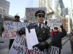 Retired Philadelphia police captain Ray Lewis, who was arrested during an Occupy Wall Street protest in New York last year, speaks at a demonstration Feb. 13 in Philadelphia.
